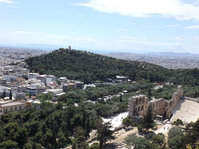 Odeum of Herodes Atticus with a view of __ in the background